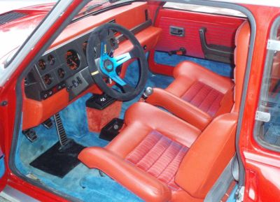 Interior Renault 5 turbo original. Naranja y azul.